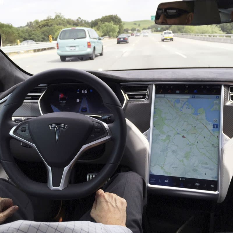 FILE PHOTO: The interior of a Tesla Model S is shown in autopilot mode in San Francisco