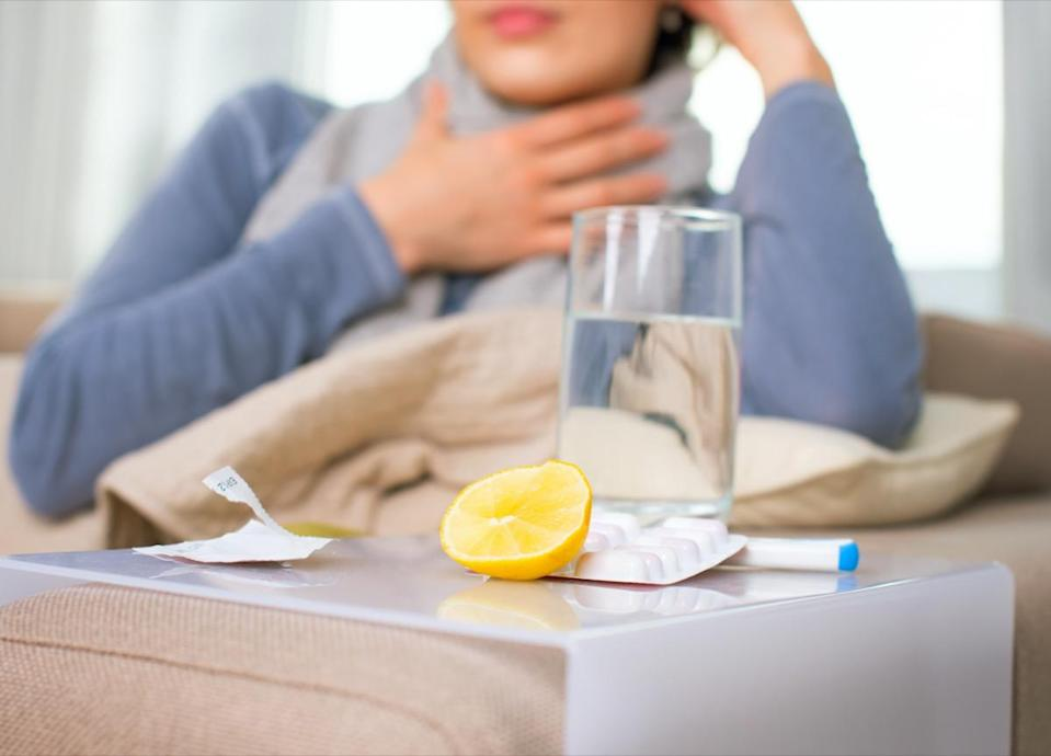 Sick woman and cold remedies.