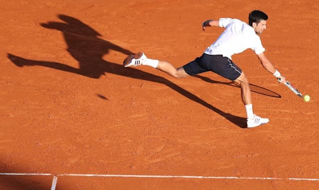 Serbia's Novak Djokovic hits a return to Belgium's David Goffin during the Monte-Carlo ATP Masters Series Tournament tennis match in Monaco (AFP Photo/VALERY HACHE)