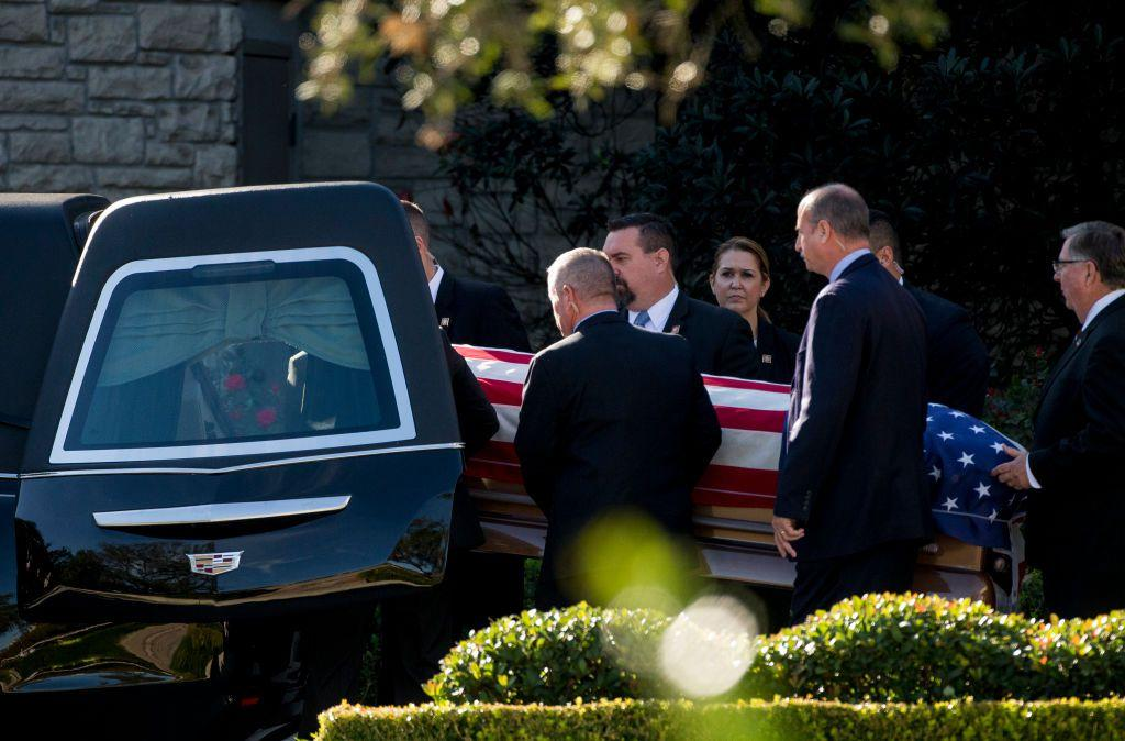 <p>George H.W. Bush's remains are carried out of the funeral home and placed in a hearse, headed to Ellington Field. Members of the late president's secret service detail served as pallbearers.</p>
