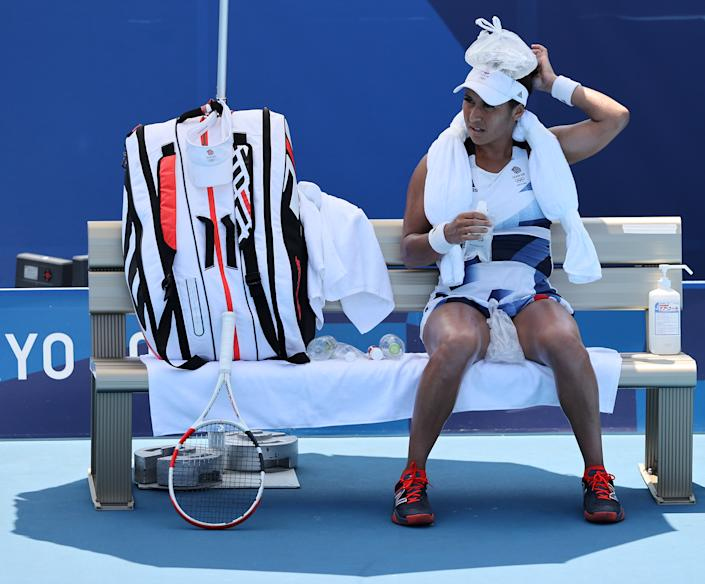 <p>Heather Watson of Team Great Britain attempts to keep cool between games during her Women's Singles First Round match against Anna-Lena Friedsam of Team Germany on day one of the Tokyo 2020 Olympic Games at Ariake Tennis Park on July 24, 2021 in Tokyo, Japan. (Photo by Clive Brunskill/Getty Images)</p>