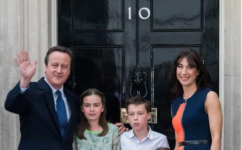 <span>The Cameron family outside their old home, somewhere in London</span> <span>Credit: Nils Jorgensen/REX/Shutterstock </span>