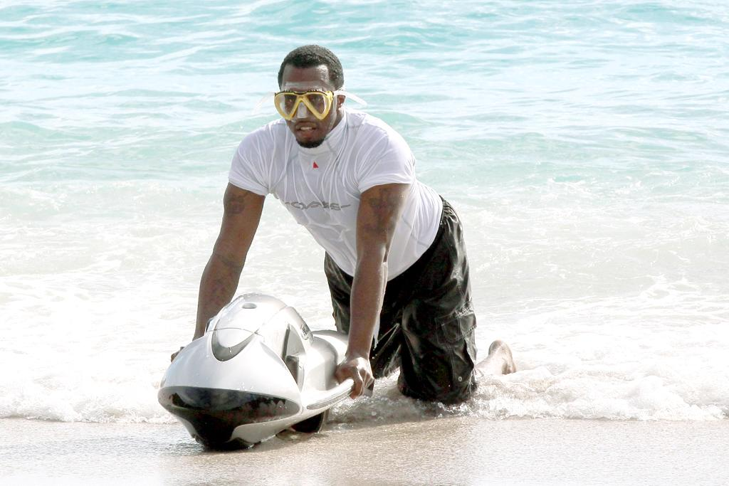 December 27, 2012: Sean Combs, aka Diddy, takes a swim while on holiday in St. Barth, French West Indies.