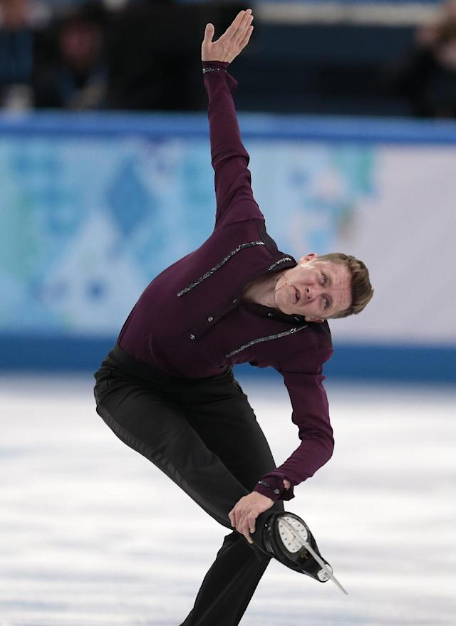 Jeremy Abbott of the United States competes in the men's team short program figure skating competition at the Iceberg Skating Palace during the 2014 Winter Olympics, Thursday, Feb. 6, 2014, in Sochi, Russia