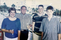 In this photo provided by Brett Eagleson, Sept. 11th victim Bruce Eagleson, stands with his wife Gail, left, and children Tim and Brett while on vacation in February of 2001. Eagleson and others who have lost family on Sept 11th are seeking the release of FBI documents that allege Saudi Arabia's role in the terrorist attacks. A lawsuit that accuses Saudi Arabia of being complicit took a major step forward this year with the questioning under oath of former Saudi officials, but those depositions remain under seal and the U.S. has withheld a trove of other documents as too sensitive for disclosure. (Brett Eagleson via AP)