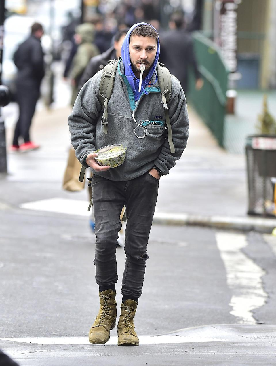 <p>How do you make a gray Patagonia fleece and combat boots look even more normcore? Hold a salad in your hands and fork in your mouth, obviously. </p>