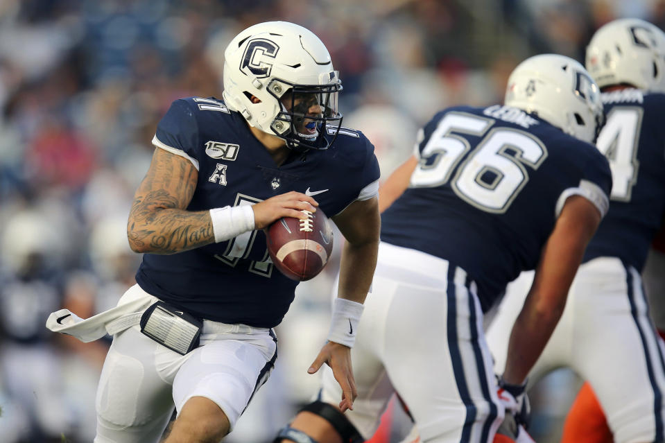 FILE - In this Sept. 7, 2019, file photo, Connecticut quarterback Jack Zergiotis (11) rolls out of the pocket during an NCAA football game against Illinois in East Hartford, Conn. UConn has canceled its 2020-2021 football season, becoming the first FBS program to suspend football because of the coronavirus pandemic. (AP Photo/Stew Milne, File)