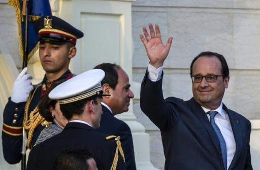 Hollande inks deals in Egypt visit dogged by rights criticism
