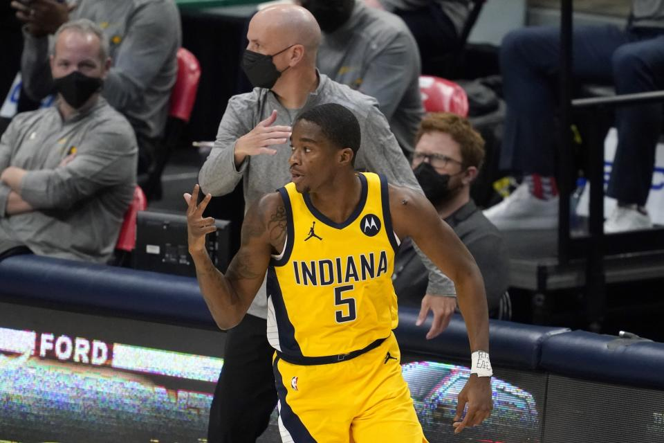 Indiana Pacers guard Edmond Sumner celebrates sinking a 3-point basket during the first half of the team's NBA basketball game against the Dallas Mavericks in Dallas, Friday, March 26, 2021. (AP Photo/Tony Gutierrez)