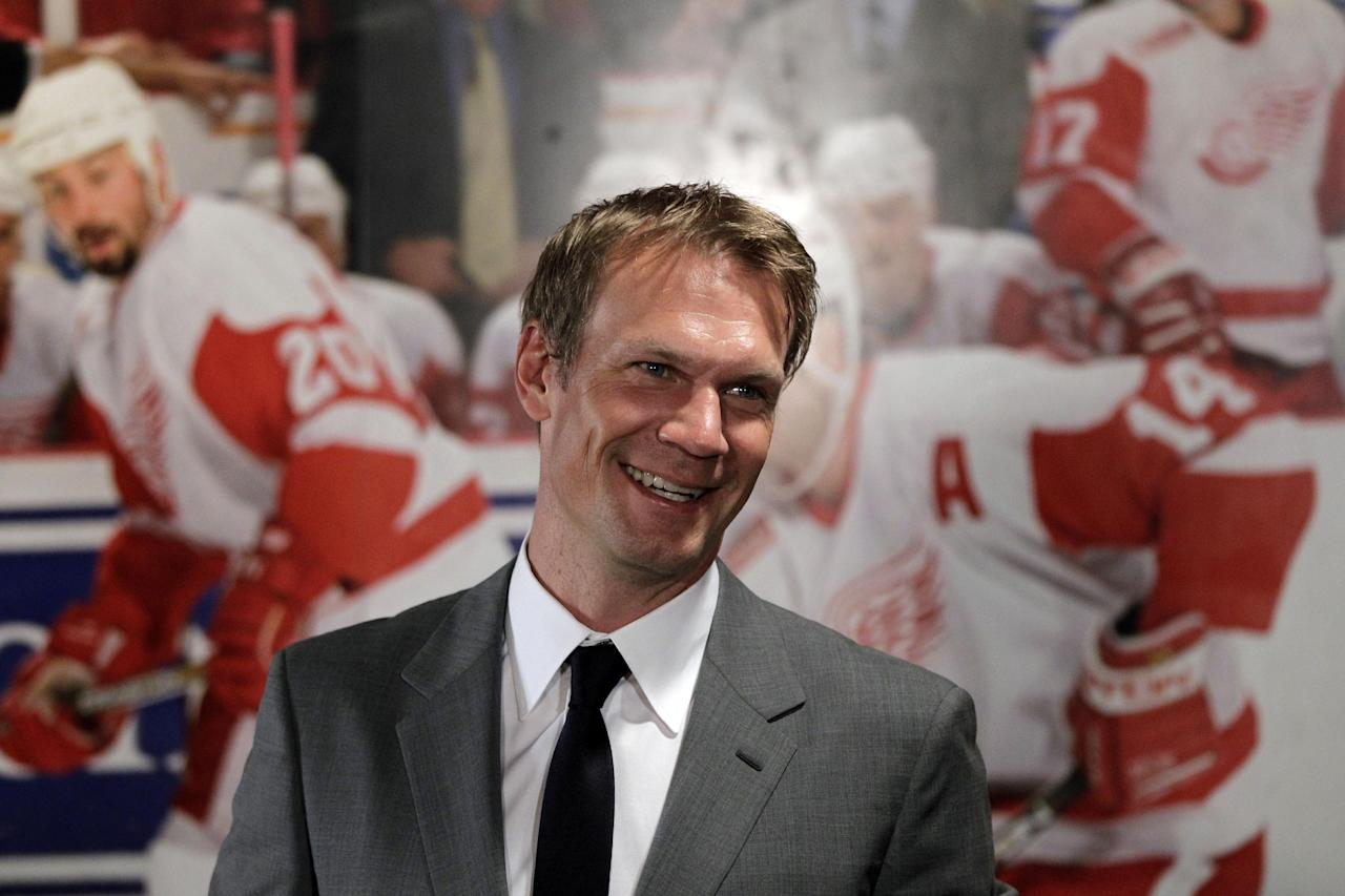 Detroit Red Wings captain Nicklas Lidstrom of Sweden is interviewed after announcing his retirement in Detroit, Thursday, May 31, 2012. Lidstrom retires after a 20-season career. (AP Photo/Carlos Osorio)