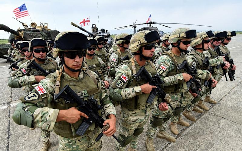 NATO and Georgian forces take part in joint exercises at the Vaziani training center near Tbilisi in August 2018 (AFP Photo/Vano SHLAMOV)