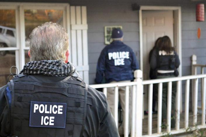 ICE agents at a home in Atlanta, during a targeted enforcement operation aimed at immigration fugitives, re-entrants and at-large criminal aliens. (Photo: Bryan Cox/ICE via AP)