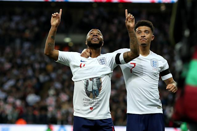 Raheem Sterling celebrates his goal to make it 3-0, showing a t-shirt in memory of Damary Dawkins (photo by Shaun Brooks/Action Plus via Getty Images)
