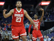 Bradley's Elijah Childs (10) celebrates after making a three-point basket as teammate Dwayne Lautier-Ogunleye (23) looks on during the second half of an NCAA college basketball game against Missouri State in the quarterfinal round of the Missouri Valley Conference tournament, Friday, March 8, 2019, in St. Louis. (AP Photo/Jeff Roberson)