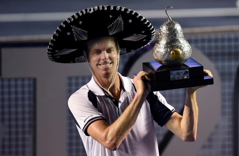 Sam Querrey of the US celebrates with the trophy after beating Rafael Nadal of Spain 6-3, 7-6 (7/3) in the men's singles finals of the ATP Mexican Tennis Open in Acapulco, Guerrero State, Mexico, on March 4, 2017
