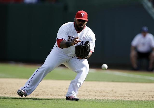 Texas Rangers first baseman Prince Fielder fields a ground ball from the Boston Red Sox in a baseball game, Sunday, May 11, 2014, in Arlington, Texas. The Red Sox won 5-2. (AP Photo/Tony Gutierrez)