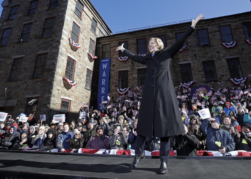 U.S. Sen. Elizabeth Warren, D-Mass., acknowledges cheers as she takes the stage during an event to formally launch her presidential campaign, Saturday, Feb. 9, 2019, in Lawrence, Mass. (AP Photo/Elise Amendola)