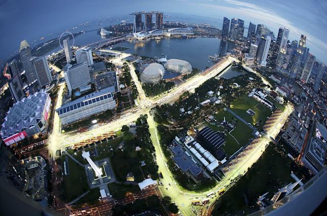 A birdeye view of the Singapore F1 Grand Prix's Marina Bay City Circuit, shot with a fish-eye lens, is seen at dusk from Swissotel The Stamford in Singapore, Tuesday, Sept. 17, 2013. The race is slated for September 21-23. (AP Photo/Wong Maye-E)