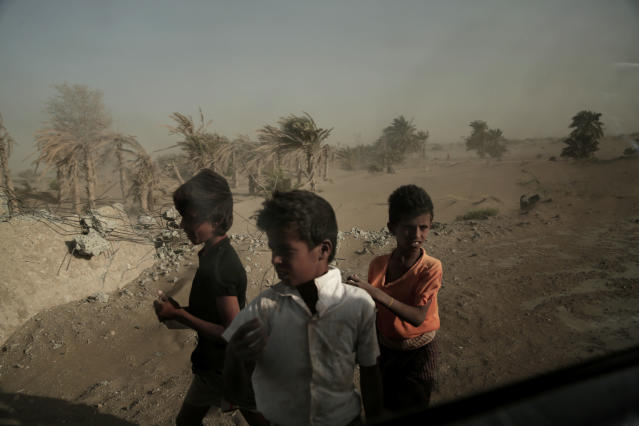 <p>In this Feb. 12, 2018 photo, homeless children stand on the road from Khoukha to Taiz in Yemen. Nearly a third of Yemen's population _ 8.4 million of its 29 million people _ are one step away from famine. That number grew by a quarter over the past year, as more and more people's ability to support themselves collapsed. A wider swath of the population, 18 million, needs some sort of food assistance, according to the World Food Program. (Photo: Nariman El-Mofty/AP) </p>