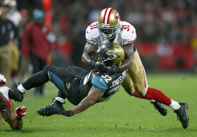 San Francisco 49ers strong safety Donte Whitner brings down Jacksonville Jaguars running back Maurice Jones-Drew in the third quarter during their NFL football game at Wembley Stadium in London, October 27, 2013. REUTERS/Andrew Winning (BRITAIN - Tags: SPORT FOOTBALL)