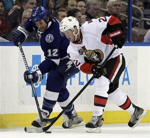Ottawa Senators right wing Erik Condra (22) battles with Tampa Bay Lightning left wing Ryan Malone (12) for the puck during the first period of an NHL hockey game Tuesday, March 6, 2012, in Tampa, Fla. (AP Photo/Chris O'Meara)
