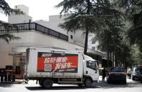 Tight security outside U.S. Chengdu consulate as staff inside prepare to leave, after China ordered its closure in response to U.S. order for China to shut its consulate in Houston