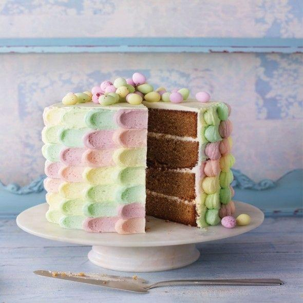 """<p>This stunning Easter cake is made with Simnel-inspired flavours. The icing is easier than it looks.</p><p><strong>Recipe: <a href=""""https://www.goodhousekeeping.com/uk/food/recipes/easter-rainbow-cake"""" rel=""""nofollow noopener"""" target=""""_blank"""" data-ylk=""""slk:Easter rainbow cake"""" class=""""link rapid-noclick-resp"""">Easter rainbow cake</a></strong></p>"""