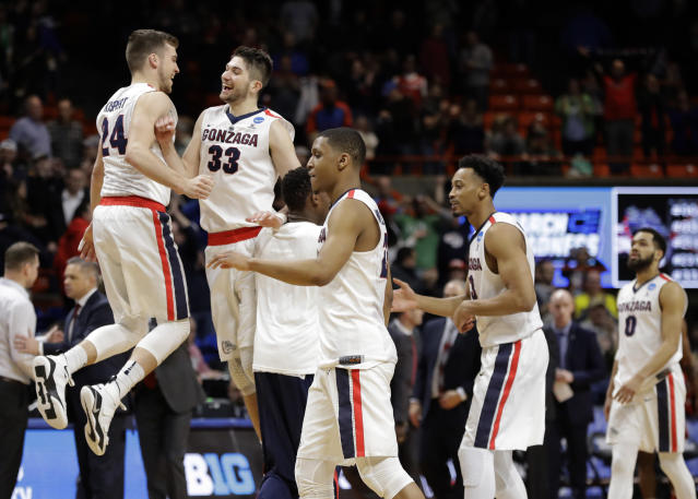 Gonzaga's Corey Kispert, left, and Killian Tillie (33) celebrate following a second-round game against Ohio State in the NCAA men's college basketball tournament Saturday, March 17, 2018, in Boise, Idaho. (AP Photo/Otto Kitsinger)
