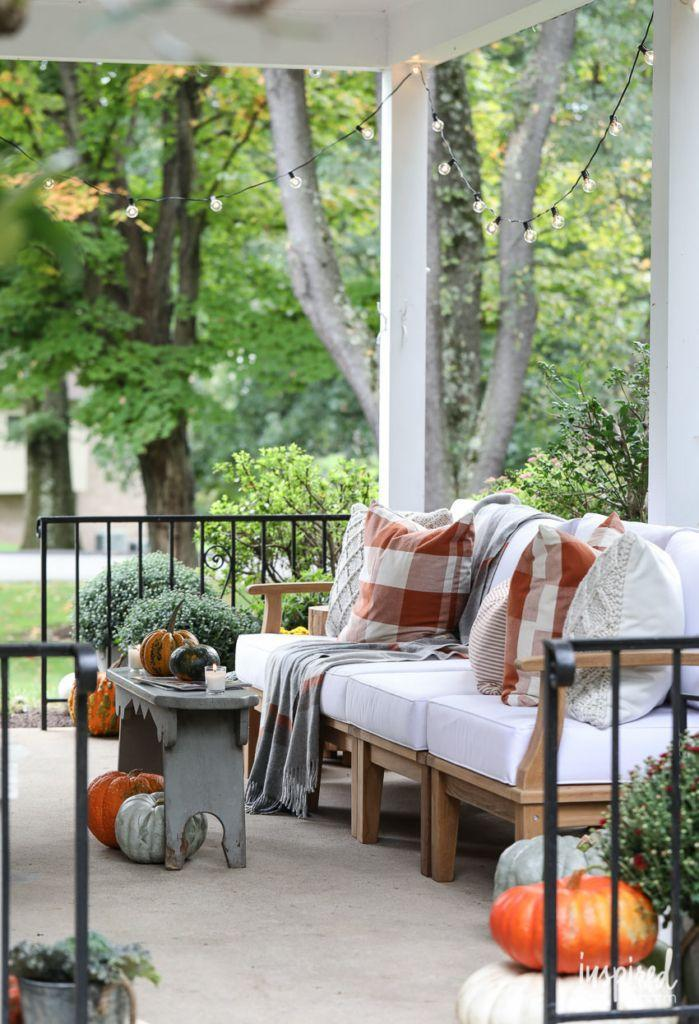 """<p>For a covered patio, the easiest way to secure the strands is simply attaching them to each corner of the roof. It makes hanging lights look uniform—not messy.</p><p><strong>See more at <a href=""""https://inspiredbycharm.com/fall-porch-decorating-ideas/"""" rel=""""nofollow noopener"""" target=""""_blank"""" data-ylk=""""slk:Inspired by Charm"""" class=""""link rapid-noclick-resp"""">Inspired by Charm</a>.</strong></p><p><strong><a class=""""link rapid-noclick-resp"""" href=""""https://www.amazon.com/Outdoor-Commercial-Perfect-Backyard-Umbrella/dp/B07B61XR58?tag=syn-yahoo-20&ascsubtag=%5Bartid%7C10050.g.3404%5Bsrc%7Cyahoo-us"""" rel=""""nofollow noopener"""" target=""""_blank"""" data-ylk=""""slk:SHOP STRING LIGHTS"""">SHOP STRING LIGHTS</a><br></strong></p>"""