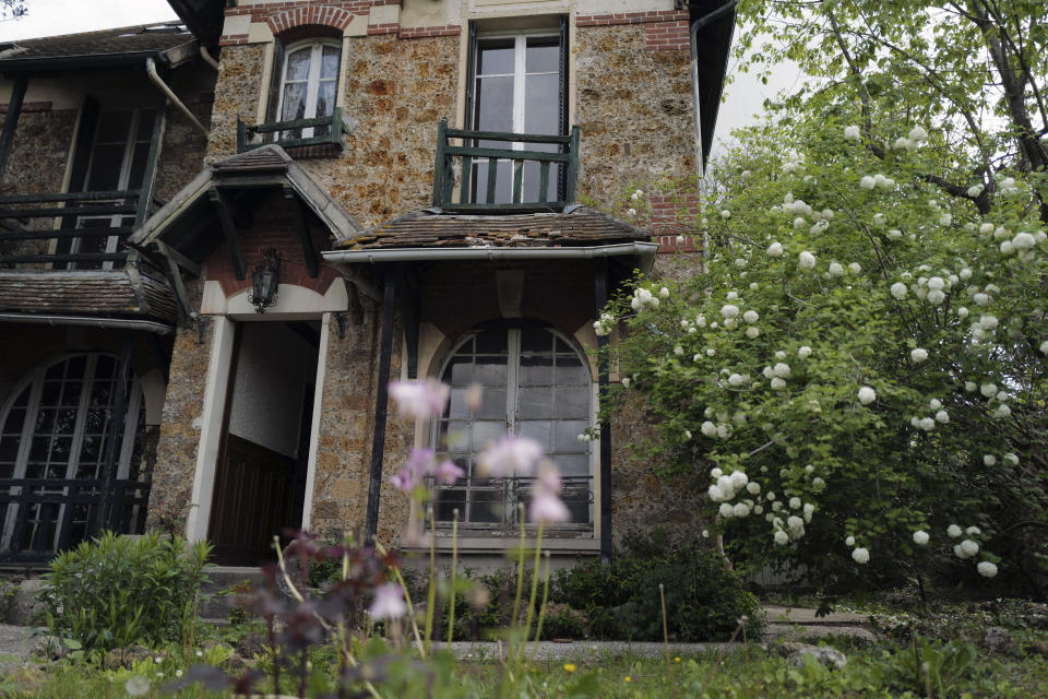 """The front door of the 120 sq. meters (1,300 sq. feet) stone house where the Nobel-winning scientist couple Marie Sklodowska-Curie and Pierre Curie spent vacation and weekends from 1904-1906 in Saint-Remy-les-Chevreuse, on the south-west outskirts of Paris, France, Wednesday, May 12, 2021. Poland's prime minister Mateusz Morawiecki says he's given instructions for the government to buy 790,000 euro house in France, and said on Twitter Tuesday that the house, is a """"part of Poland's history."""" (AP Photo/Francois Mori)"""