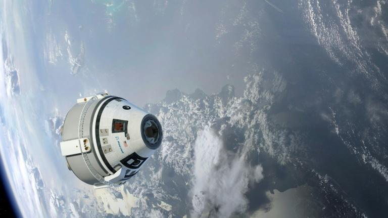 This illustration, provided by Boeing in 2015, depicts the Starliner capsule in Earth orbit (AFP Photo/HO)