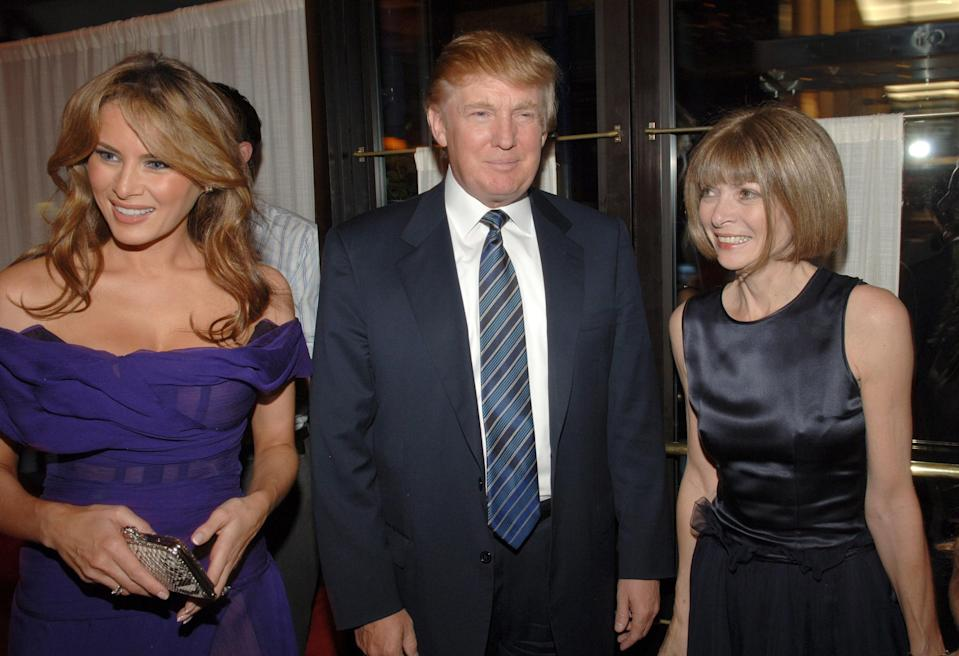 Donald and Melania Trump photographed alongside Anna Wintour back in 2005 [Photo: Getty]