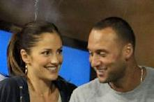 Minka Kelly and Derek Jeter of the New York Yanklees watch as Novak Djokovic of Serbia plays against James Blake of the United States during his men's singles match on day six of the 2010 U.S. Open at the USTA Billie Jean King National Tennis Center on September 4, 2010 in the Flushing neighborhood of the Queens borough of New York City on September 4, 2010 -- Getty Images