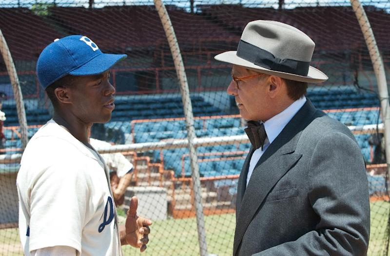 """This film image released by Warner Bros. Pictures shows Chadwick Boseman as Jackie Robinson, left, and Harrison Ford as Branch Rickey in a scene from """"42."""" (AP Photo/Warner Bros. Pictures, D. Stevens)"""