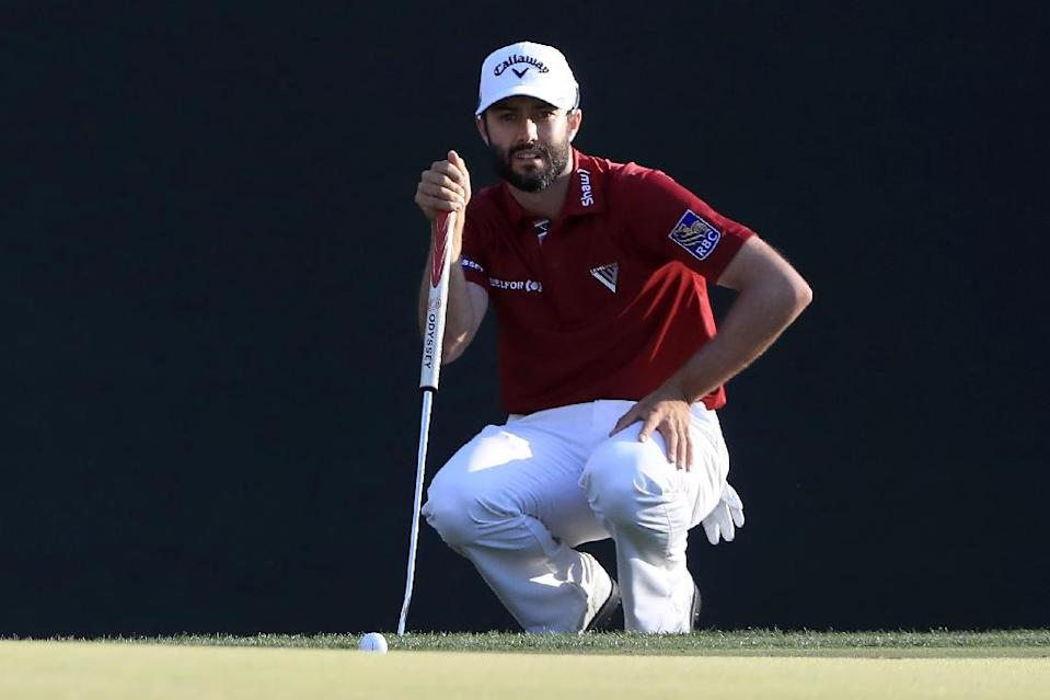 Canada's Adam Hadwin putts on the 16th green during the third round of the Valspar Championship on March 11, 2017 in Palm Harbor, Florida (AFP Photo/SAM GREENWOOD)