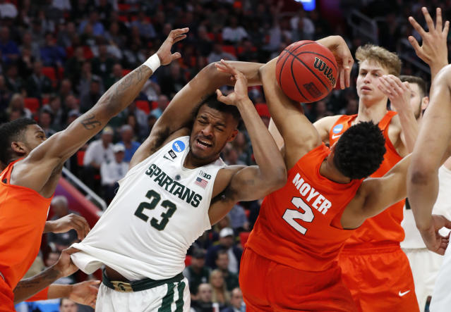 Michigan State forward Xavier Tillman (23) and Syracuse forward Matthew Moyer (2) battle for a rebound during the first half of an NCAA men's college basketball tournament second-round game in Detroit, Sunday, March 18, 2018. (AP Photo/Paul Sancya)