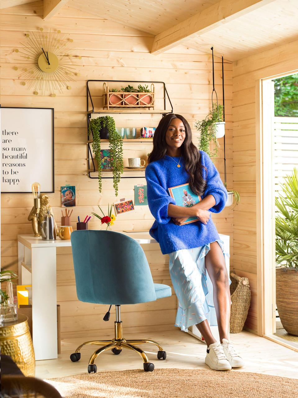 """<p><strong>TV presenter AJ Odudu has extended her outdoor living space with the addition of a fun, flexible and WFH-friendly summer house.</strong></p><p>AJ wanted to be able to use her garden all year round, come rain or shine, and in doing so created the perfect outdoor spot in the garden of her London home. The summer house is divided up into several areas: </p><ol><li><strong>Garden office: </strong>This is the ultimate work from home space with pops of colour, cheerful wall art and decor, display shelving and lots of greenery.</li><li><strong>Self-care corner/ wellness zone: </strong>AJ carved out a relaxing 'me' space in the summer house, perfect for yoga & home workouts, meditation and for indulging in a good book in the reading corner.<br></li><li><strong>Outdoor entertaining: </strong>At the front of the summer house is a bright, colourful, summer-ready lounge set up for 'rule of six' garden entertaining. </li></ol><p>'I have added insulation, electricity and the Internet into the <a href=""""https://go.redirectingat.com?id=127X1599956&url=https%3A%2F%2Fwww.wayfair.co.uk%2Fgarden%2Fpdp%2Fdakota-fields-goldsberry-19-x-10-ft-tongue-and-groove-summer-house-kbdx1043.html&sref=https%3A%2F%2Fwww.housebeautiful.com%2Fuk%2Fgarden%2Fg36462362%2Faj-odudu-garden-summer-house%2F"""" rel=""""nofollow noopener"""" target=""""_blank"""" data-ylk=""""slk:summer house"""" class=""""link rapid-noclick-resp"""">summer house</a> so that I can maximise its use all year round,' explains AJ, who revamped her outdoor space with the help of design experts at <a href=""""https://go.redirectingat.com?id=127X1599956&url=https%3A%2F%2Fwww.wayfair.co.uk%2F&sref=https%3A%2F%2Fwww.housebeautiful.com%2Fuk%2Fgarden%2Fg36462362%2Faj-odudu-garden-summer-house%2F"""" rel=""""nofollow noopener"""" target=""""_blank"""" data-ylk=""""slk:Wayfair"""" class=""""link rapid-noclick-resp"""">Wayfair</a>. 'It's a really versatile space, perfect for zoom meetings, workouts or chilling with a drink in the seating area, which can be adapted for 2021 and beyond.'</"""