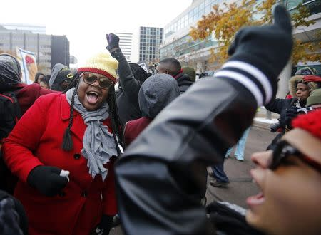 Demonstrators take part in a protest in front of the building where the grand jury is looking into the shooting death of Michael Brown in Clayton, Missouri, November 17, 2014.    REUTERS/Jim Young