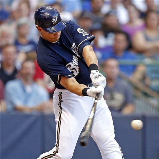 Milwaukee Brewers' Cody Ransom connects for a three-run home run off Arizona Diamondbacks' Wade Miley during the fourth inning of a baseball game on Saturday, June 30, 2012, in Milwaukee. (AP Photo/Tom Lynn)