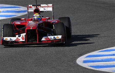 Ferrari Formula One driver Felipe Massa of Brazil takes a curve as he drives the new F138 during a training session at the Jerez racetrack in southern Spain February 7, 2013. REUTERS/Marcelo del Pozo