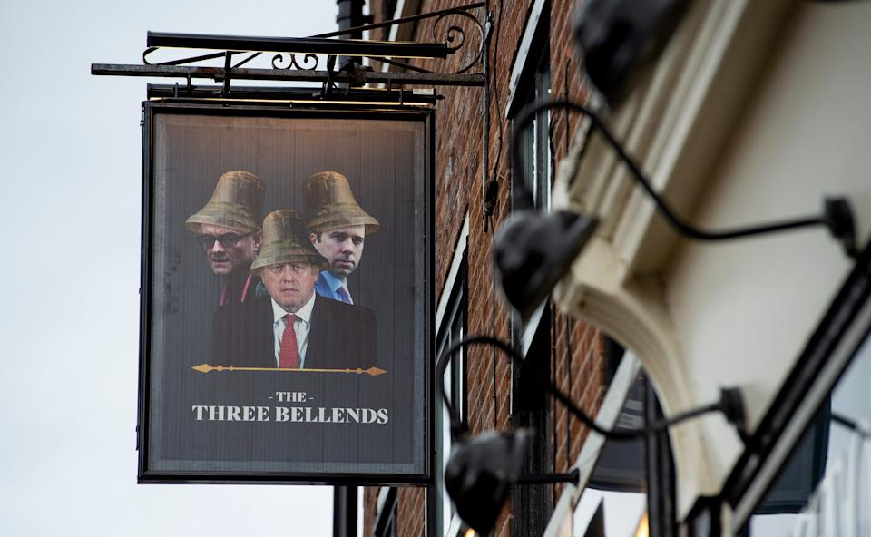 An image of Britains's Prime Minister Boris Johnson, Britains Health Secretary Matt Hancock and Number 10 Special advisor Dominic Cummings, is pictured on a sign outside a pub re-branded as 'The Three Bellends', in protest against the government's handling of the coronavirus pandemic , New Brighton, Wirral, Britain, 14 October 2020. New Local lockdown measures came into force in the Liverpool City Region on 14 October 2020.  EPA/PETER POWELLEPA