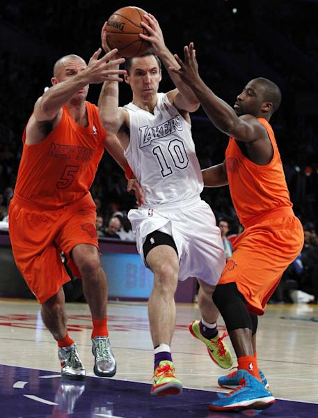 Los Angeles Lakers guard Steve Nash (10) drives between New York Knicks guards Jason Kidd (5) and Raymond Felton (2) during the first half of their NBA basketball game in Los Angeles, Tuesday, Dec. 25, 2012. (AP Photo/Alex Gallardo)