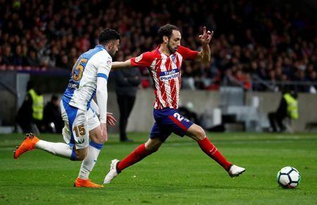 Soccer Football - La Liga Santander - Atletico Madrid vs Leganes - Wanda Metropolitano, Madrid, Spain - February 28, 2018 Atletico Madrid's Juanfran in action with Leganes' Diego Rico REUTERS/Juan Medina
