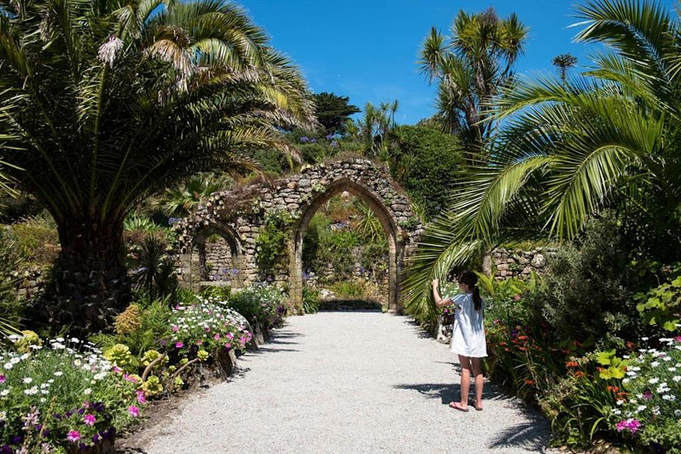 """<p>If there's one place in the UK that will make you feel like you're somewhere more tropical it's the Isles of Scilly, where you'll find white sand beaches, milder temperatures and the exotic Tresco Abbey Garden. A botanical paradise home to 20,000 plant species, this must-see garden was planted among the ruins of a Benedictine priory. </p><p>You can learn all about its secrets from the Isles of Scilly's top guide Will Wagstaff as he takes you to see the archipelago's highlights in May 2021, including the unspoilt beaches, wildlife spotting and the best viewpoints.</p><p><a class=""""link rapid-noclick-resp"""" href=""""https://www.countrylivingholidays.com/tours/isles-of-scilly-will-wagstaff"""" rel=""""nofollow noopener"""" target=""""_blank"""" data-ylk=""""slk:FIND OUT MORE"""">FIND OUT MORE</a></p>"""