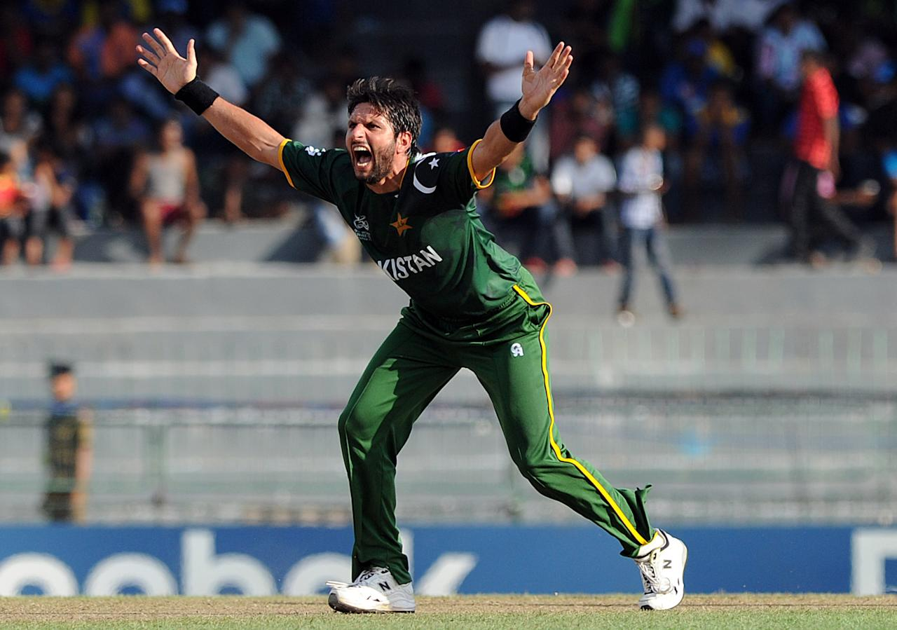 Pakistan cricketer Shahid Afridi successfully appeals for a Leg Before Wicket (LBW) decision against South African cricketer Jean-Paul Duminy during the ICC Twenty20 Cricket World Cup's Super Eight match between South Africa and Pakistan at the R. Premadasa Stadium in Colombo on September 28, 2012. AFP PHOTO / Ishara S.KODIKARA