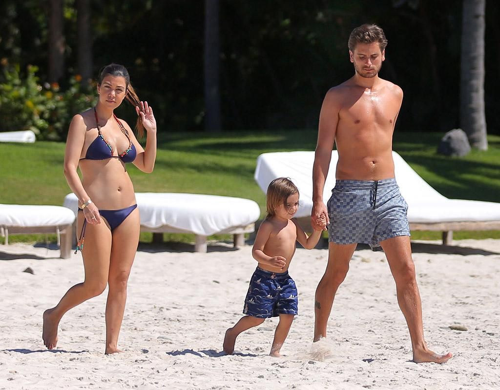 EXCLUSIVE: **PREMIUM RATES APPLY** Kourtney Kardashian and Scott Disick kiss on the beach and play with Mason in Mexico first beach vacay since baby Penelope's birth. The couple were staying at their friend Joe Francis's house and over a few days had a blast playing on the beach and enjoying their time as a family. Kourtney was looking in shape after having two children in her bikini, and even went into the water for with her son and boyfriend. Kourtney and Scott hugged a lot on the beach as they watched Mason play in the water and even shared a few kisses.
