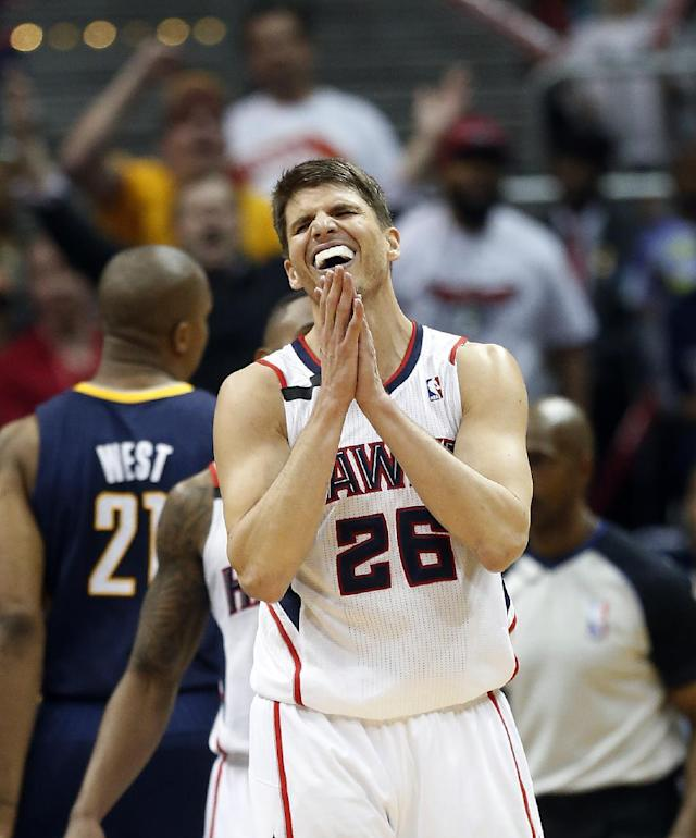 Atlanta Hawks guard Kyle Korver (26) reacts after a foul in the second half of an NBA first-round playoff basketball game against the Indiana Pacers Thursday, April 24, 2014 in Atlanta. Atlanta won 98-85 to take a 2-1 lead in the best-of-seven series. . (AP Photo/John Bazemore)