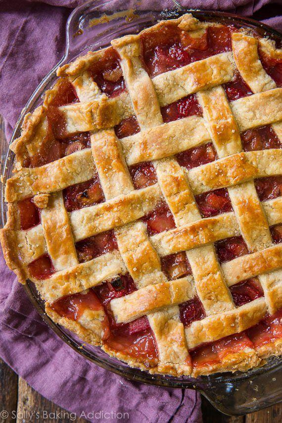 """<p>This beauty is a double-crust pie with a lattice top, but you can switch it up with a crumble topping, too. </p><p><strong>Get the recipe at <a href=""""https://sallysbakingaddiction.com/strawberry-rhubarb-pie/"""" rel=""""nofollow noopener"""" target=""""_blank"""" data-ylk=""""slk:Sally's Baking Addiction"""" class=""""link rapid-noclick-resp"""">Sally's Baking Addiction</a>. </strong></p><p><a class=""""link rapid-noclick-resp"""" href=""""https://go.redirectingat.com?id=74968X1596630&url=https%3A%2F%2Fwww.walmart.com%2Fsearch%2F%3Fquery%3Dpioneer%2Bwoman%2Bpie%2Bpan&sref=https%3A%2F%2Fwww.thepioneerwoman.com%2Ffood-cooking%2Fmeals-menus%2Fg36558208%2Fsummer-pie-recipes%2F"""" rel=""""nofollow noopener"""" target=""""_blank"""" data-ylk=""""slk:SHOP PIE PANS"""">SHOP PIE PANS</a></p>"""