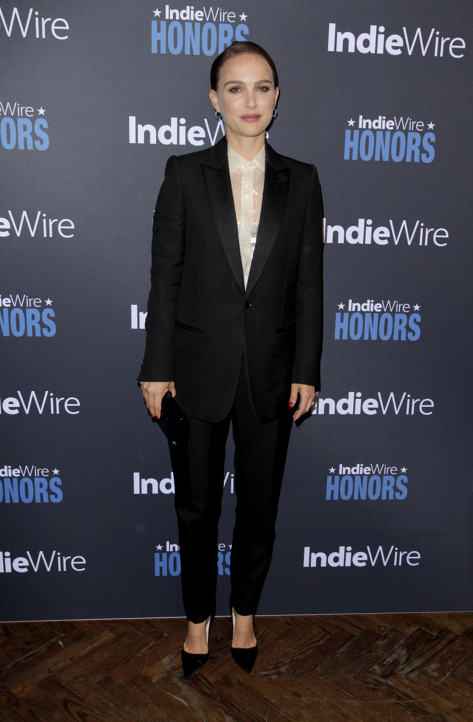 <p>Clad in a trouser suit with slicked back hair, Natalie looked every inch the successful female star. <em>[Photo: Getty]</em> </p>