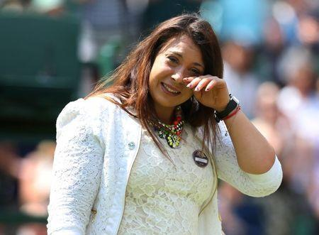 FILE PHOTO: All England Lawn Tennis & Croquet Club, Wimbledon, England - 24/6/14 France's Marion Bartoli cries on centre court before doing a coin toss during the first round Mandatory Credit: Action Images / Henry Browne Livepic